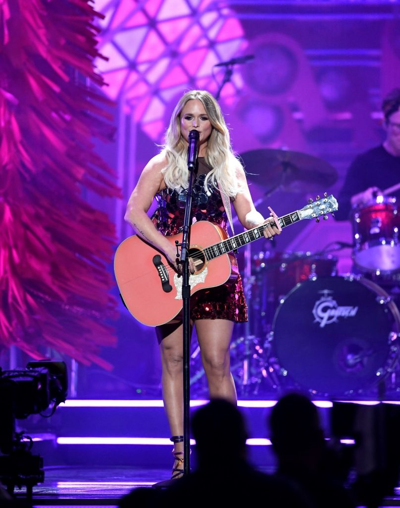 Miranda Lambert playing her guitar during a performance at award ceremony