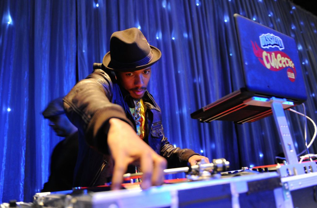 Nick Cannon DJing his birthday party. Nick Cannon's age is 30 in the photo