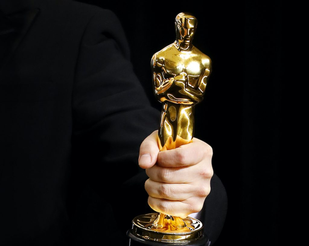 An Academy Award winner's hand holding an Oscar statue in the press room during the 90th Annual Academy Awards at Hollywood & Highland Center on March 4, 2018 in Hollywood, California