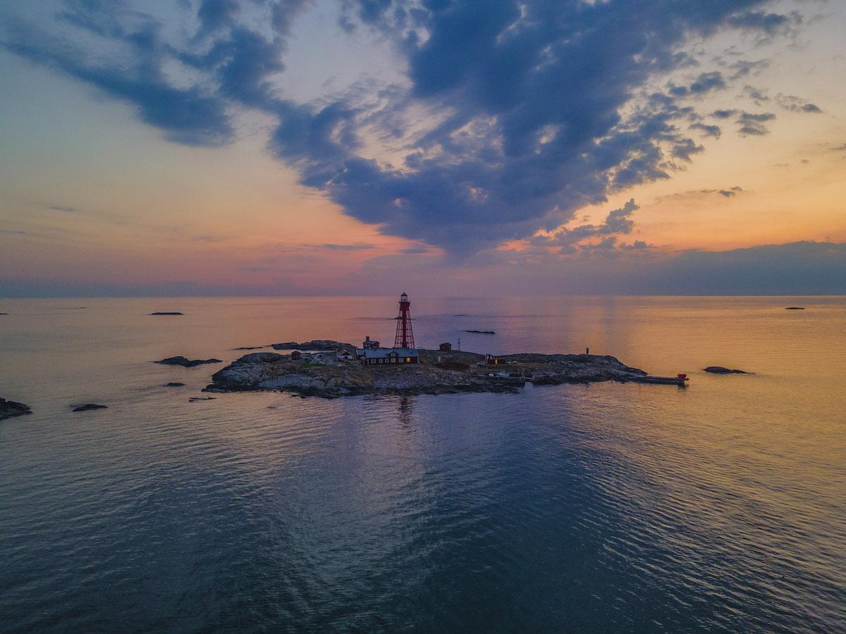 Lighthouse on an island at sunset