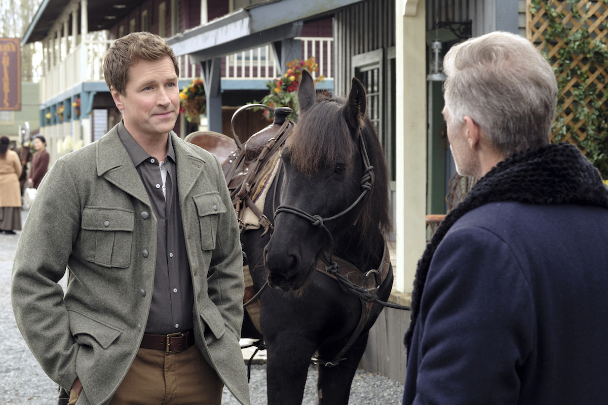 Carson Shepherd standing next to a horse in episode of When Calls the Heart
