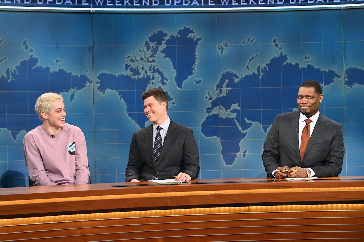 Pete Davidson, Colin Jost, and anchor Michael Che on Weekend Update on SNL
