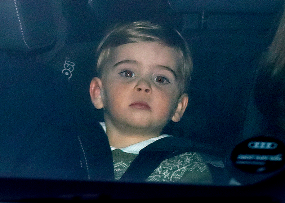 Photo of Prince Louis in car attending Christmas Lunch at Buckingham Palace