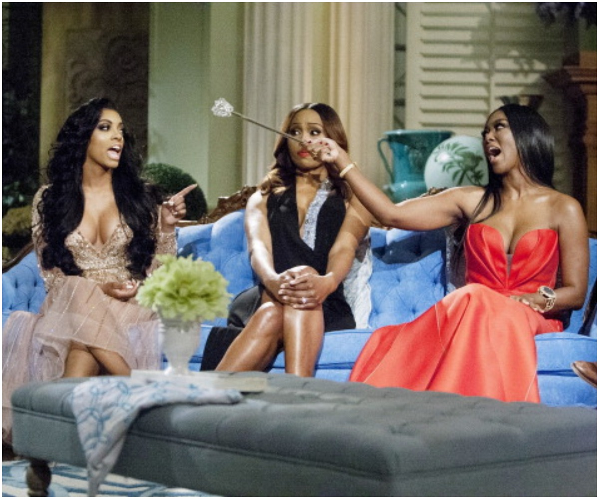 Porsha Williams and Kenya Moore from 'RHOA' arguing in between Cynthia Bailey