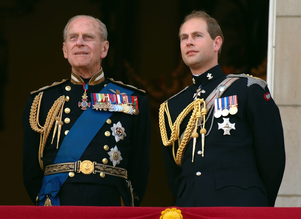 Prince Edward and Prince Philp dressed in their military uniforms as they watch the flypast over the Mall of British and US World War II aircraft from the balcony of Buckingham Palace