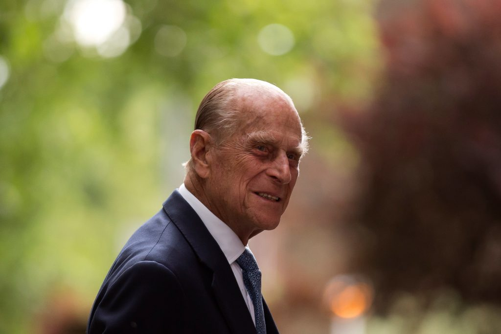 Prince Philip dressed in suit and smiles during visit to Richmond Adult Community College