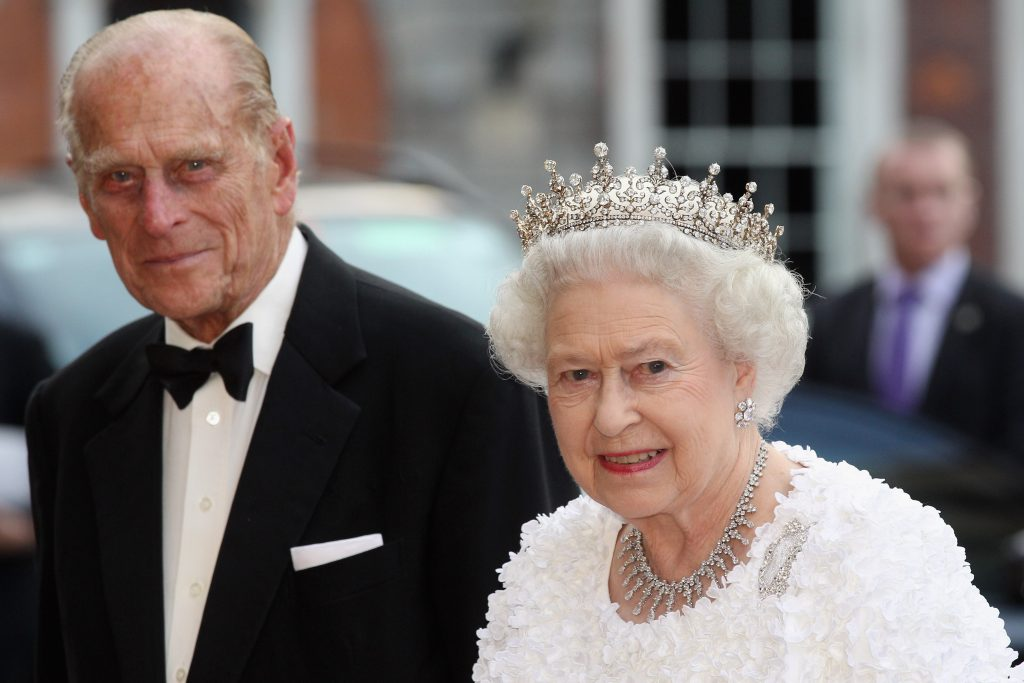 Prince Philip in a tuxedo and Queen Elizabeth in a white gown and tiara as they attend state banquet in Dublin