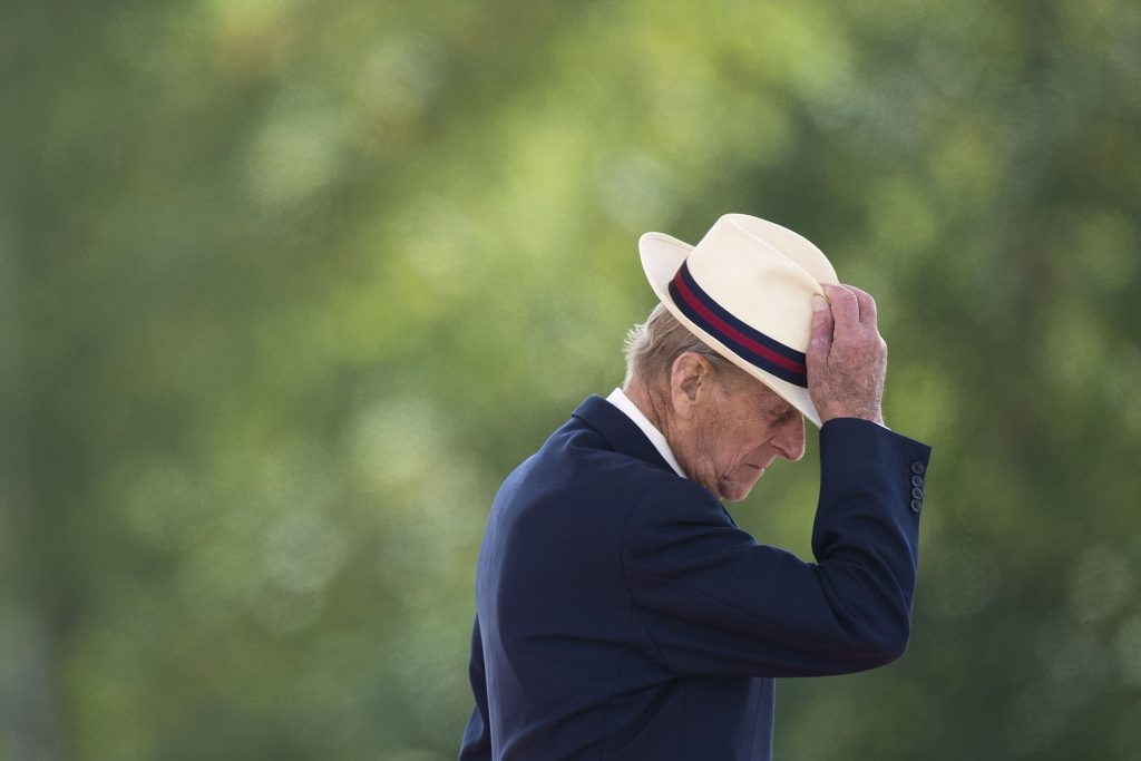 Prince Philip touching his hat and walking away after presenting medals at event in Scotland