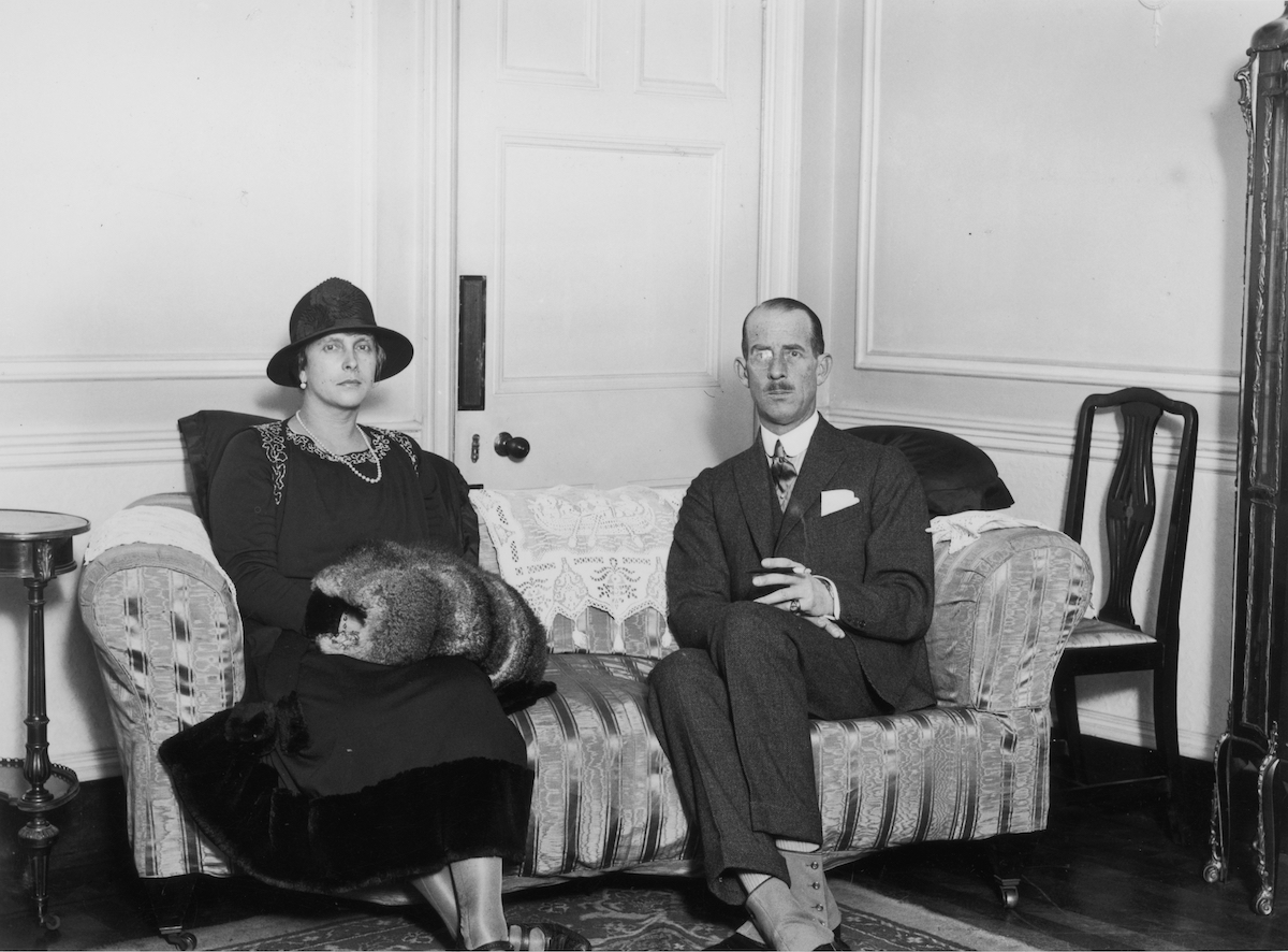 Prince Philip's parents, Princess Alice and Prince Andrew sit on opposite sides of a couch