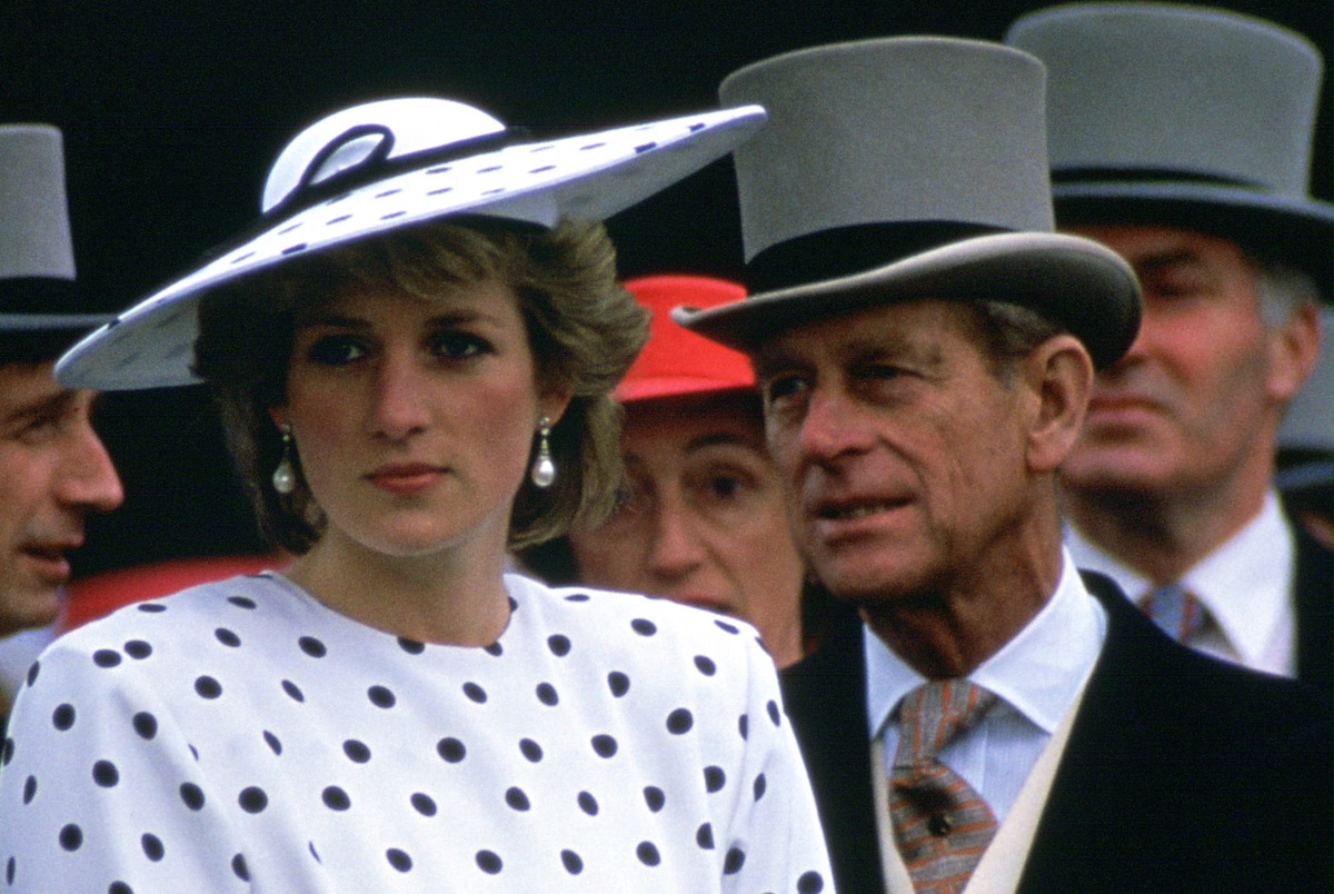 Princess Diana stands in front of Prince Philip on Derby Day