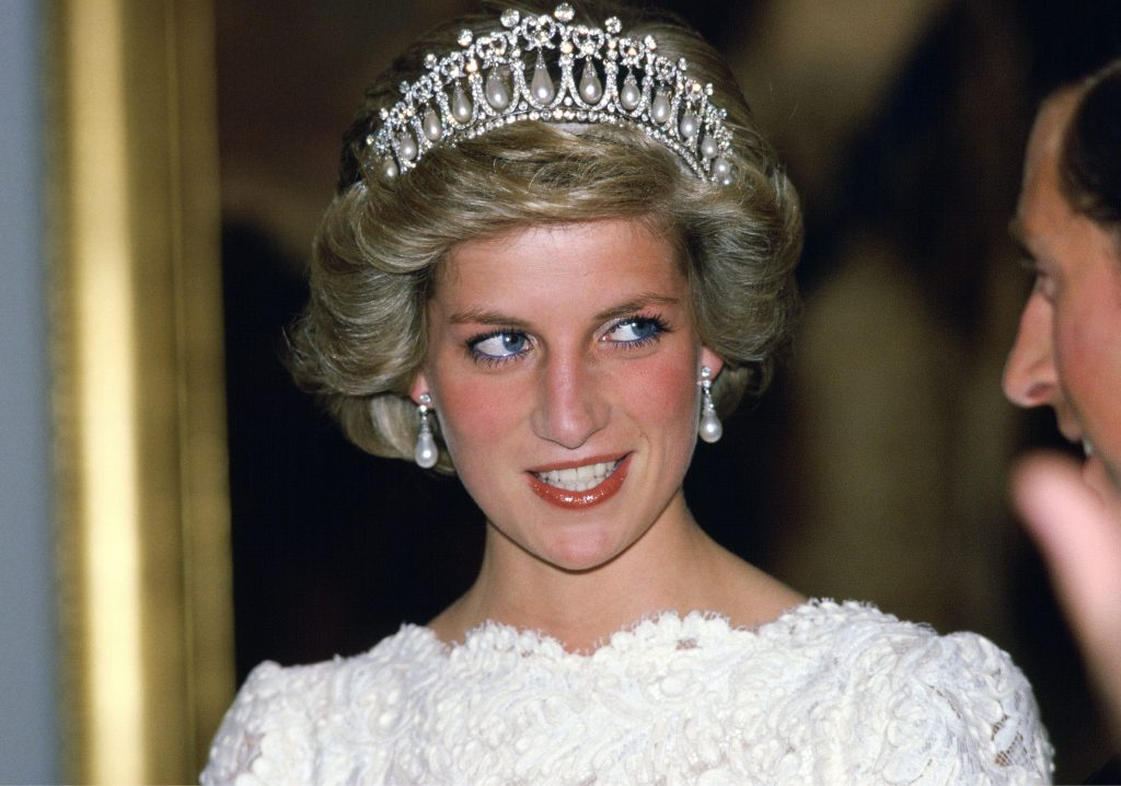 Princess Diana donning Queen Mary's Diamond And Pearl Tiara while having a conversation with Prince Charles