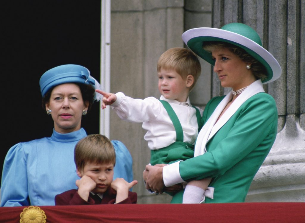 Diana, Princess Of Wales, Holding A Young Prince Harry In Her Arms As She Watches Trooping The Colour With Prince William And Princess Margaret From The Balcony Of Buckingham Palace