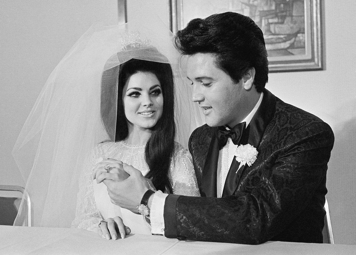 Elvis Presley shows off his wife Priscilla's three-carat diamond wedding ring on their wedding day in Las Vegas