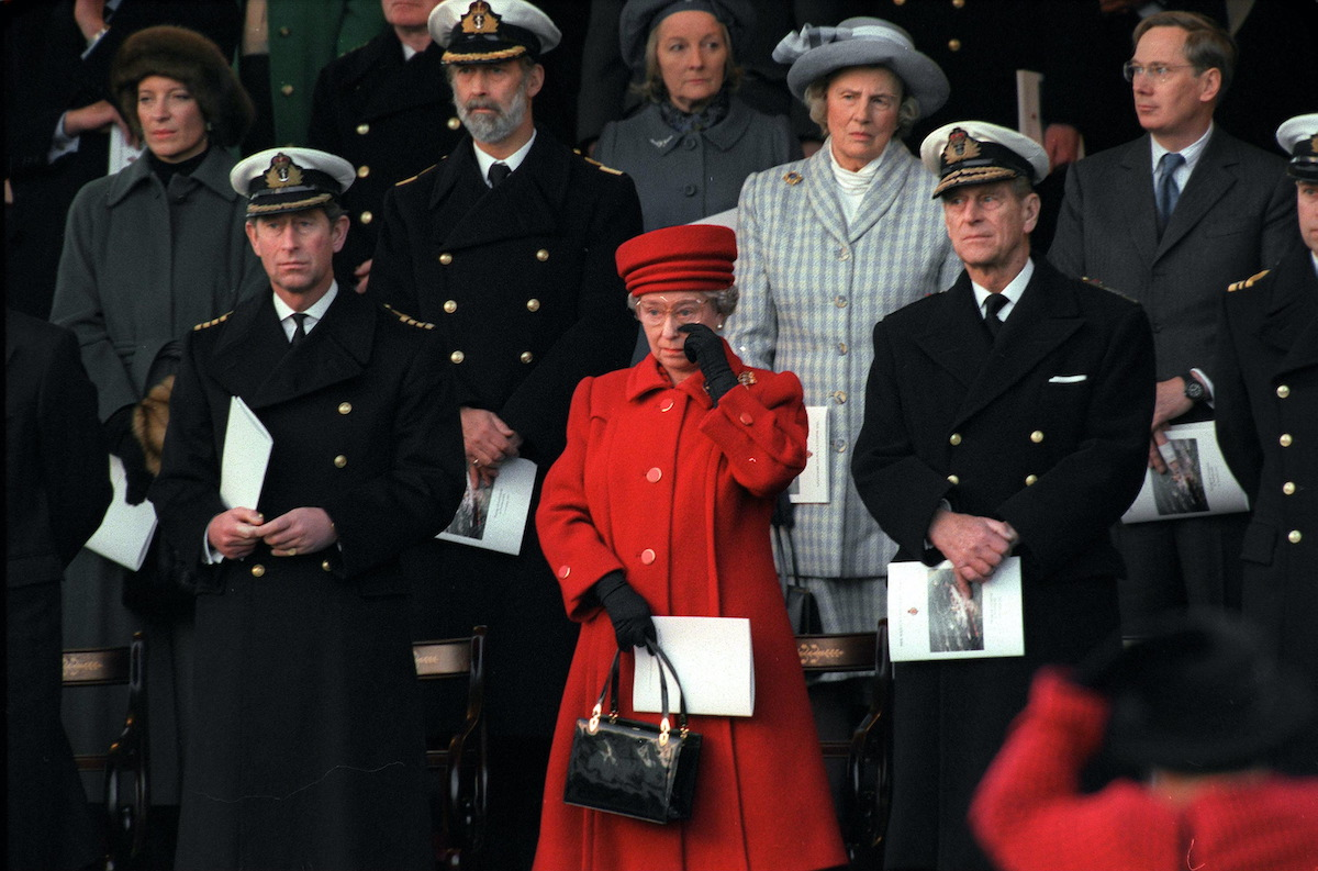 Queen Elizabeth wiping at tear at the decommissioning of Brittania