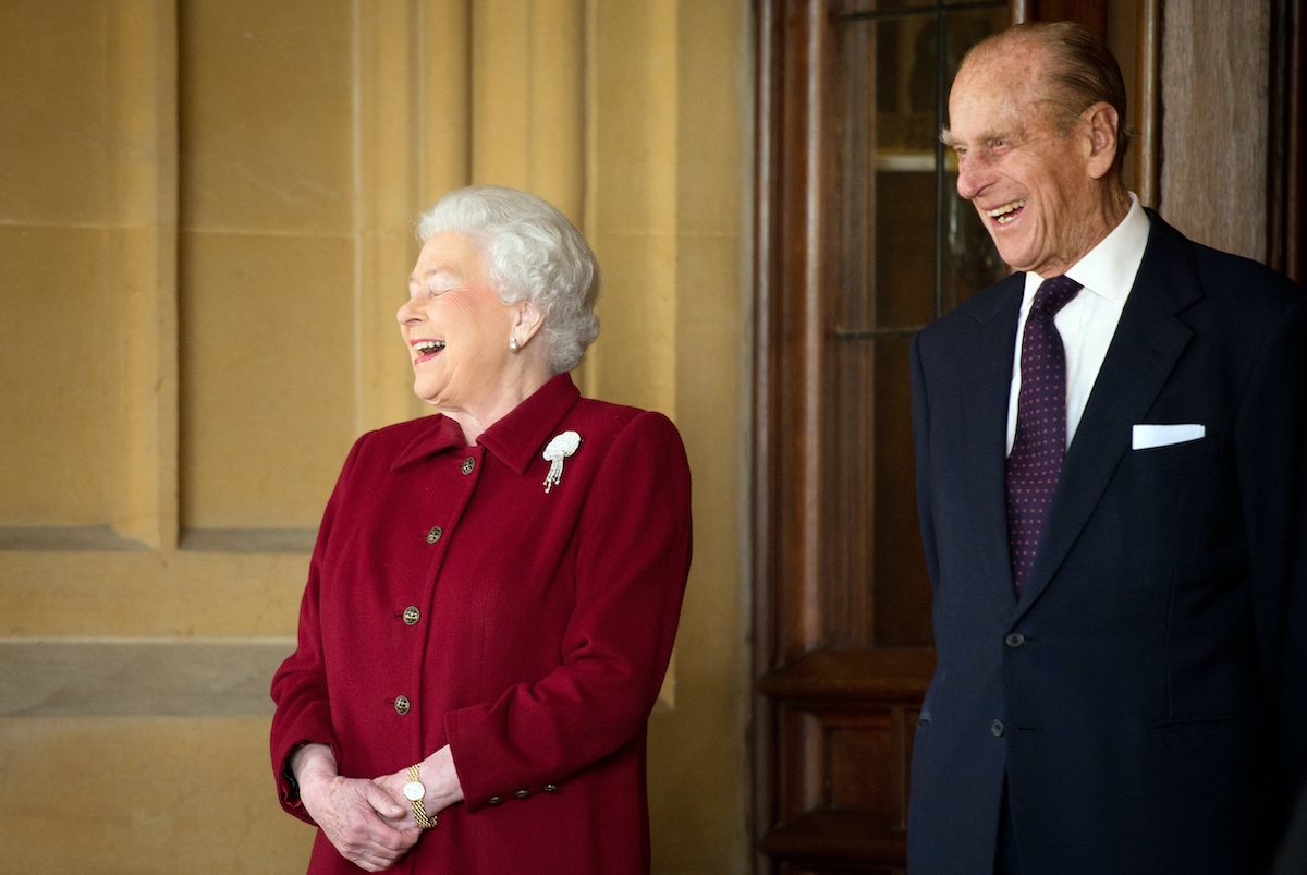 Queen Elizabeth and Prince Philip laughing together as they say goodbye to the Irish president