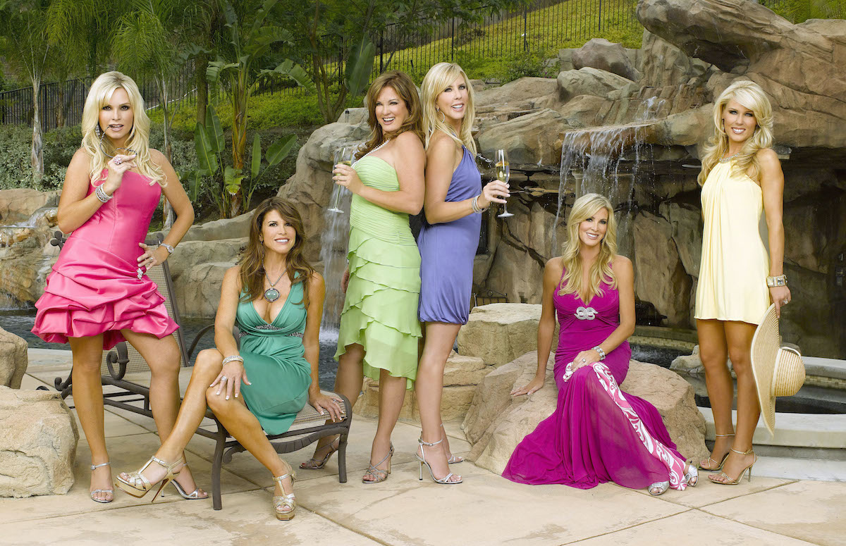 Tamra Barney, Lynne Curtin, Vicki Gunvalson, Jeana Keough, Lauri Waring, Gretchen Rossi  from The Real Housewives pose in front of a fake waterfall in Orange County cast photo