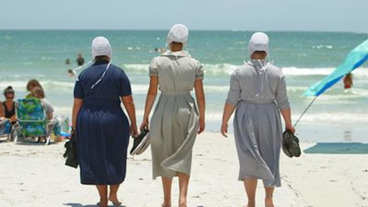 Three women from 'Breaking Amish' walking on a beach with their backs turned for 'Return to Amish'