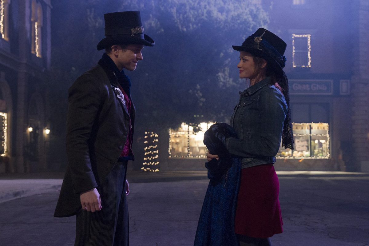 Logan Huntzberger and Rory Gilmore stand in the middle of the street in Stars Hollow during filming of 'Gilmore Girls: A Year in the Life'