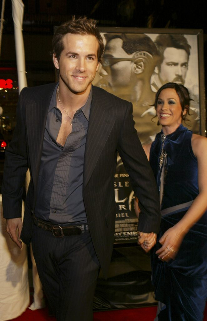 Ryan Reynolds walking the carpet and holding hands with Alanis Morissette at movie premiere
