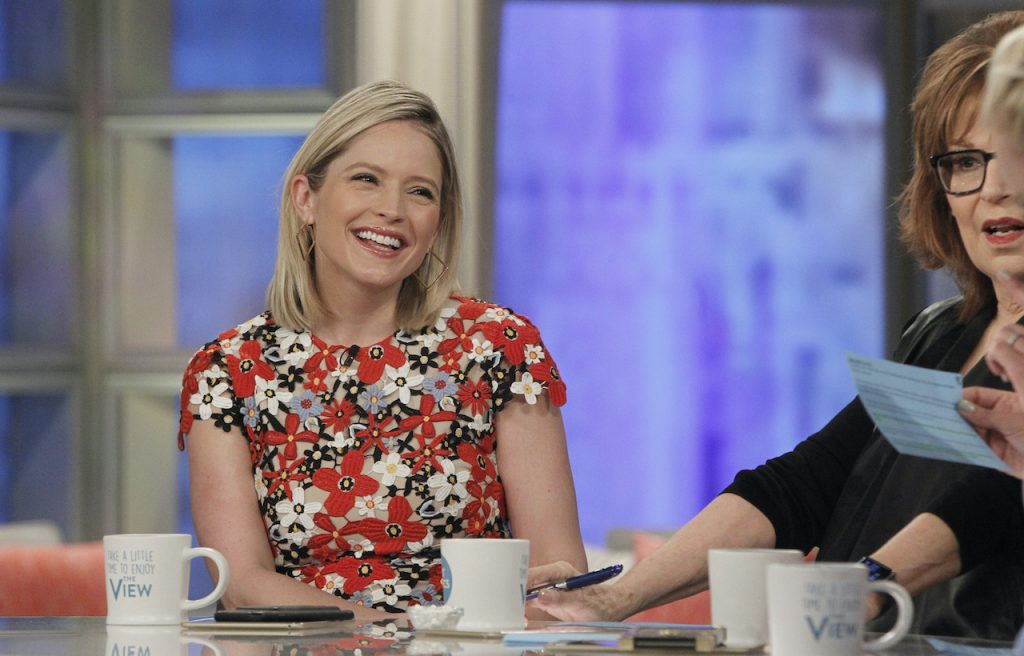 Sara Haines smiling at the desk of 'The View'