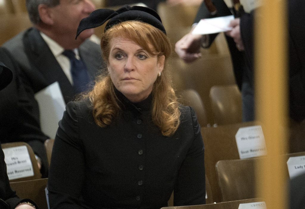 Sarah Ferguson looking somber and dressed in all black at the funeral of Baroness Margaret Thatcher