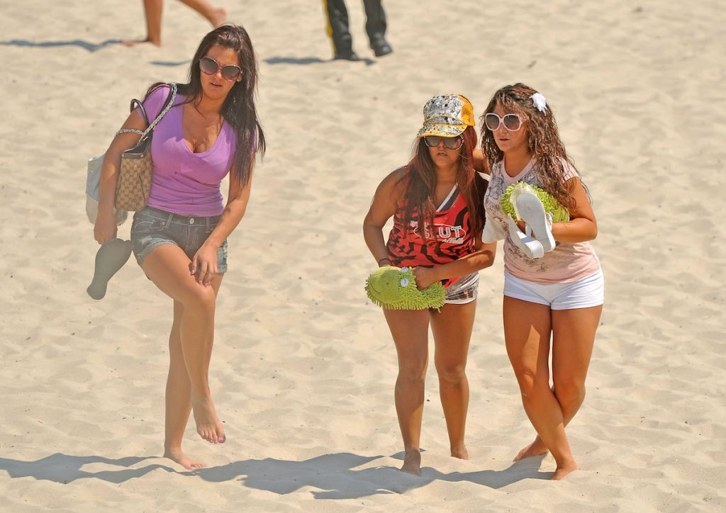 Deena Cortese and Jenni 'JWoww' Farley helping Nicole 'Snooki' Polizzi up in the fashion she wore when she was arrested