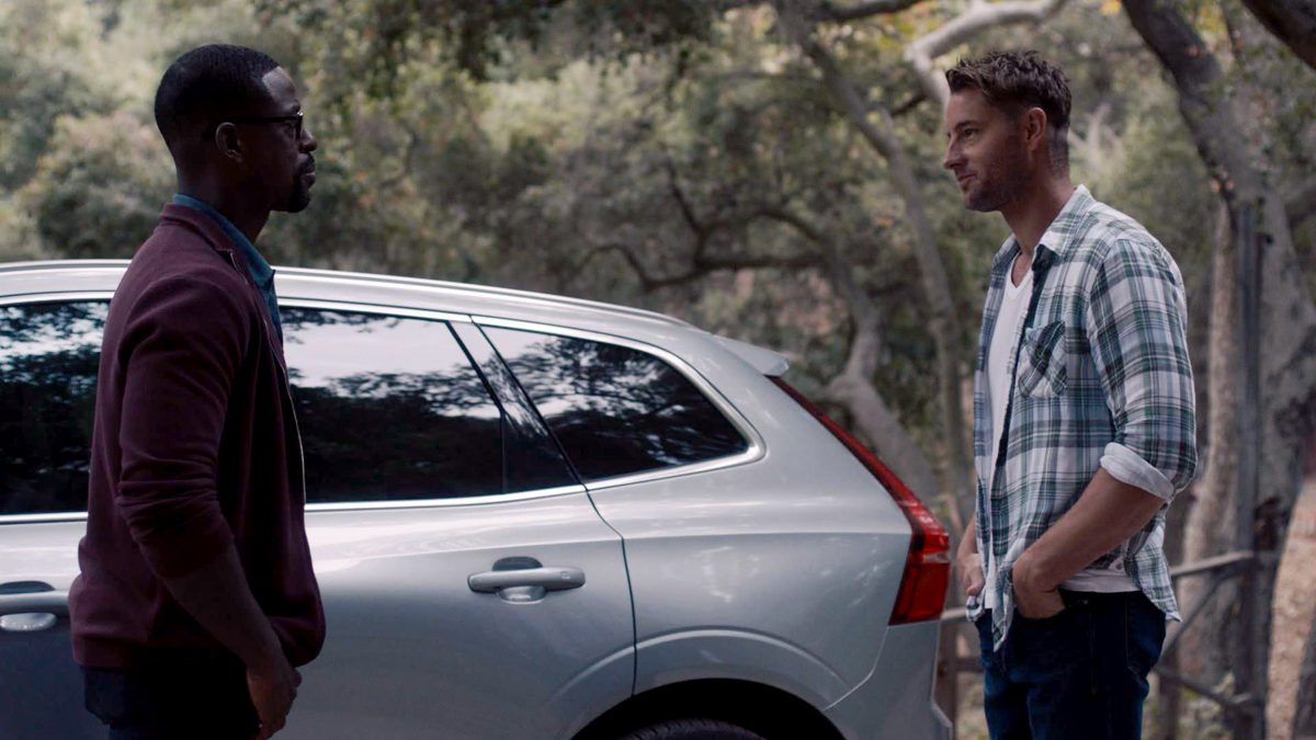 Sterling K. Brown and Justin Hartley stand by Randall's car