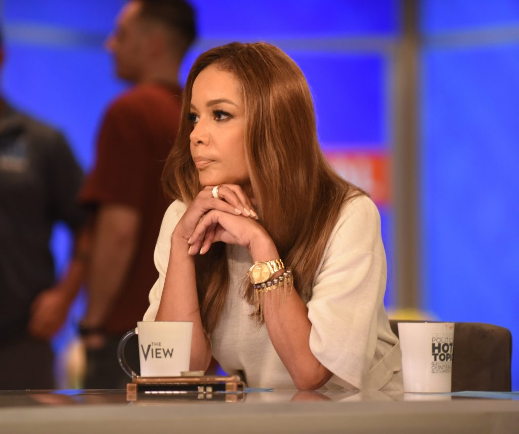 Sunny Hostin in a beige top sitting at the table of 'The View'