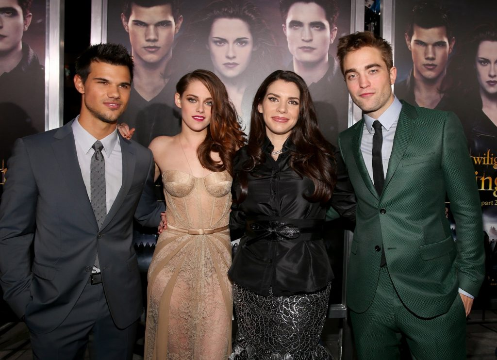 Taylor Lautner, Kristen Stewart, Stephenie Meyer, and Robert Pattinson walk the red carpet of the final Twilight movies