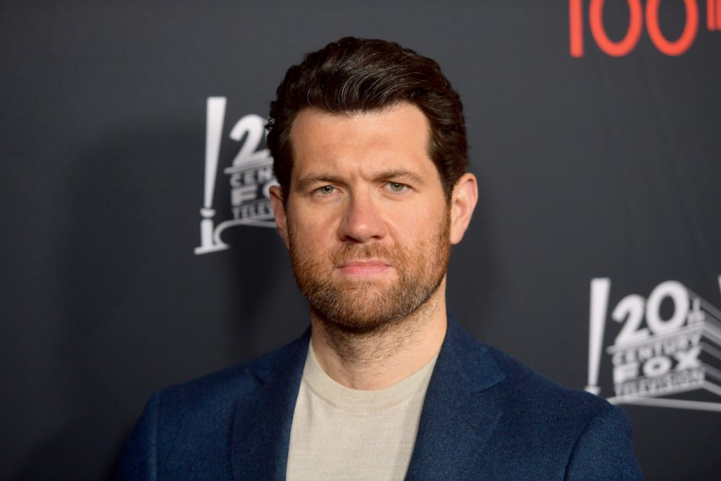 Billy Eichner in a bluet suit celebrating 100th episode of 'American Horror Story'