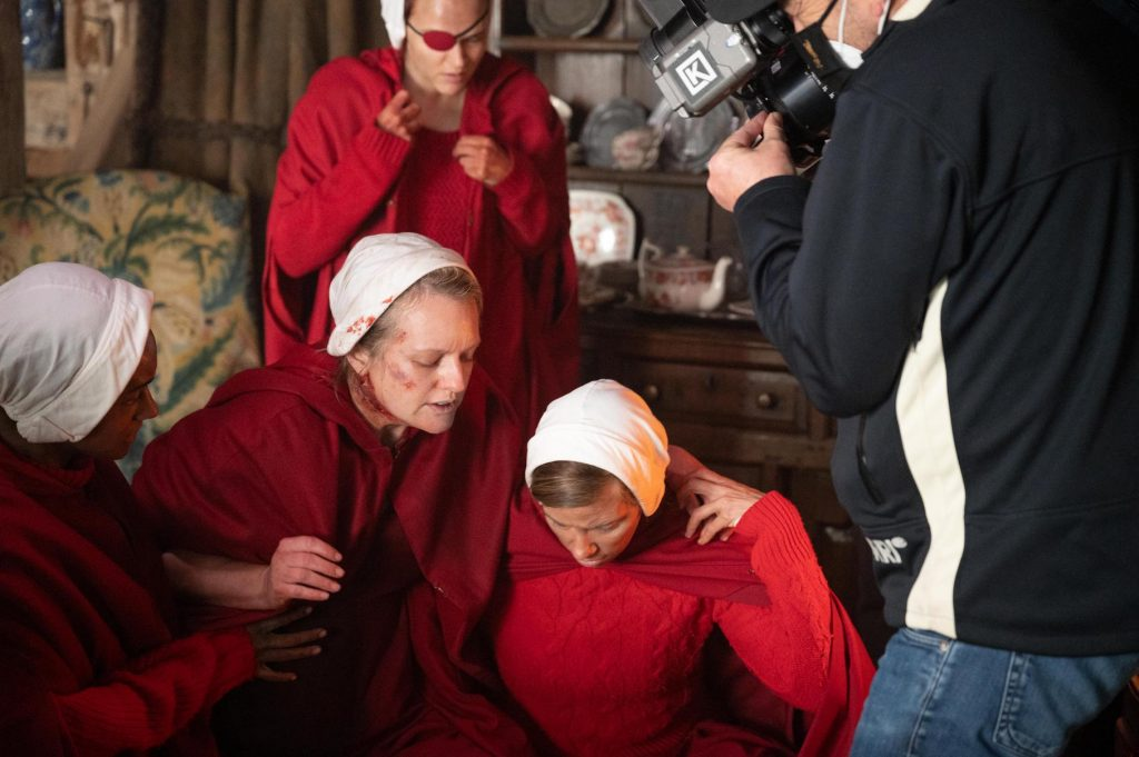 June Osborne surrounded by other handmaids and the camera crew for 'The Handmaid's Tale' Season 4