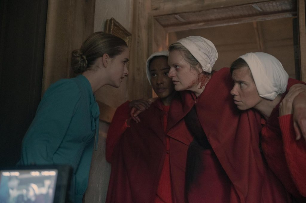 Three of the handmaids talking to Esther in 'The Handmaid's Tale' Season 4