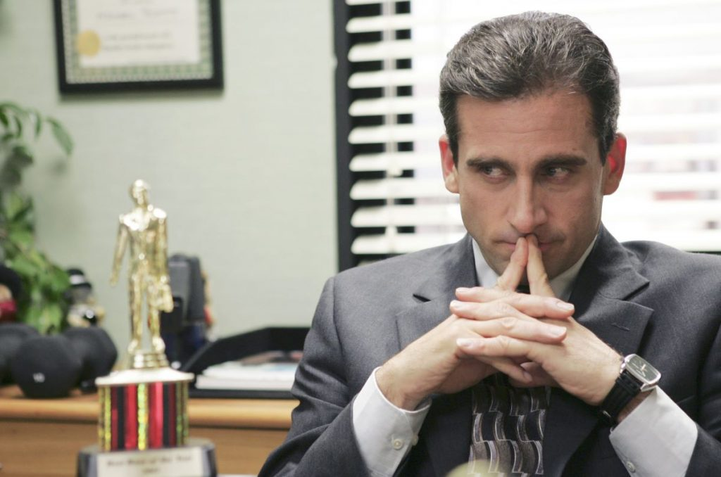 Steve Carell as Michael Scott sits in his office looking at a trophyon 'The Office'