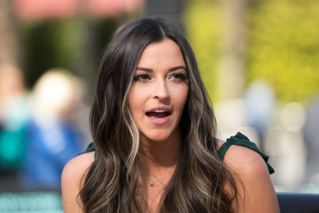 Tia Booth, Colton Underwood's ex from 'Bachelor in Paradise,' sitting and talking