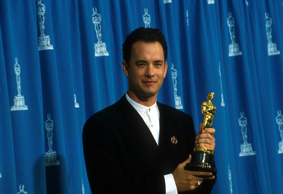 Tom Hanks receives his Oscar at the Academy Awards in Los Angeles in 1995