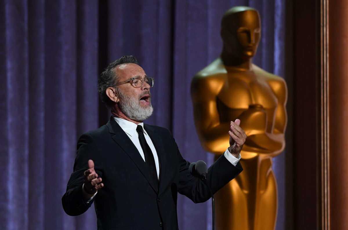 Tom Hanks standing at the Oscars Governors Awards