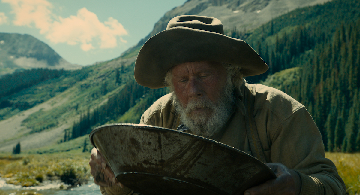 Tom Waits panning for gold in The Ballad of Buster Scruggs