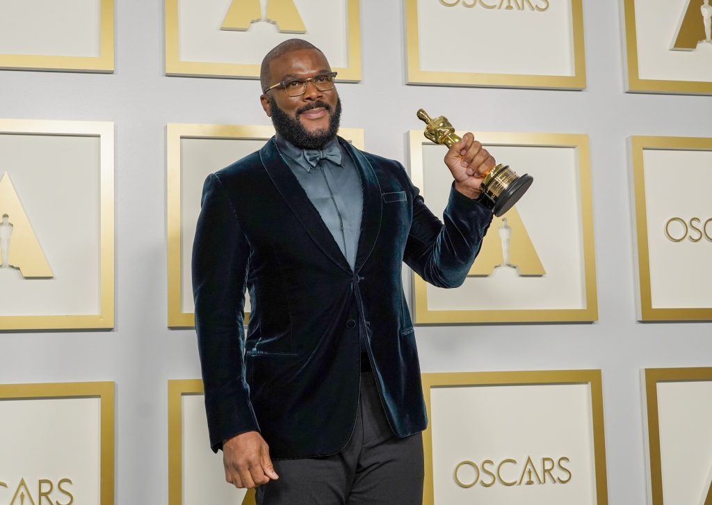 Tyler Perry poses with his hardware in press room at 93rd Oscars after winning humanitarian award