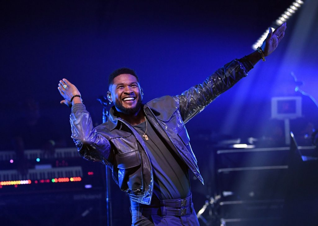 Usher smiles and performs at the iHeart Music Festival