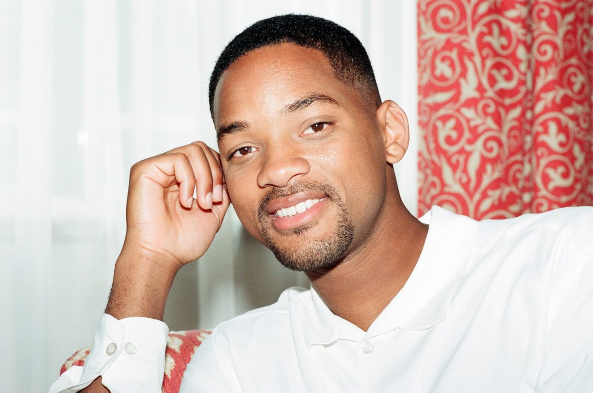 Will Smith with his fist on his cheek