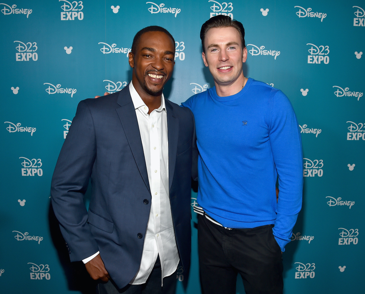 "Anthony Mackie (L) and Chris Evans of CAPTAIN AMERICA: CIVIL WAR ty at the ""Worlds, Galaxies, and Universes: Live Action at The Walt Disney Studios"" presentation"