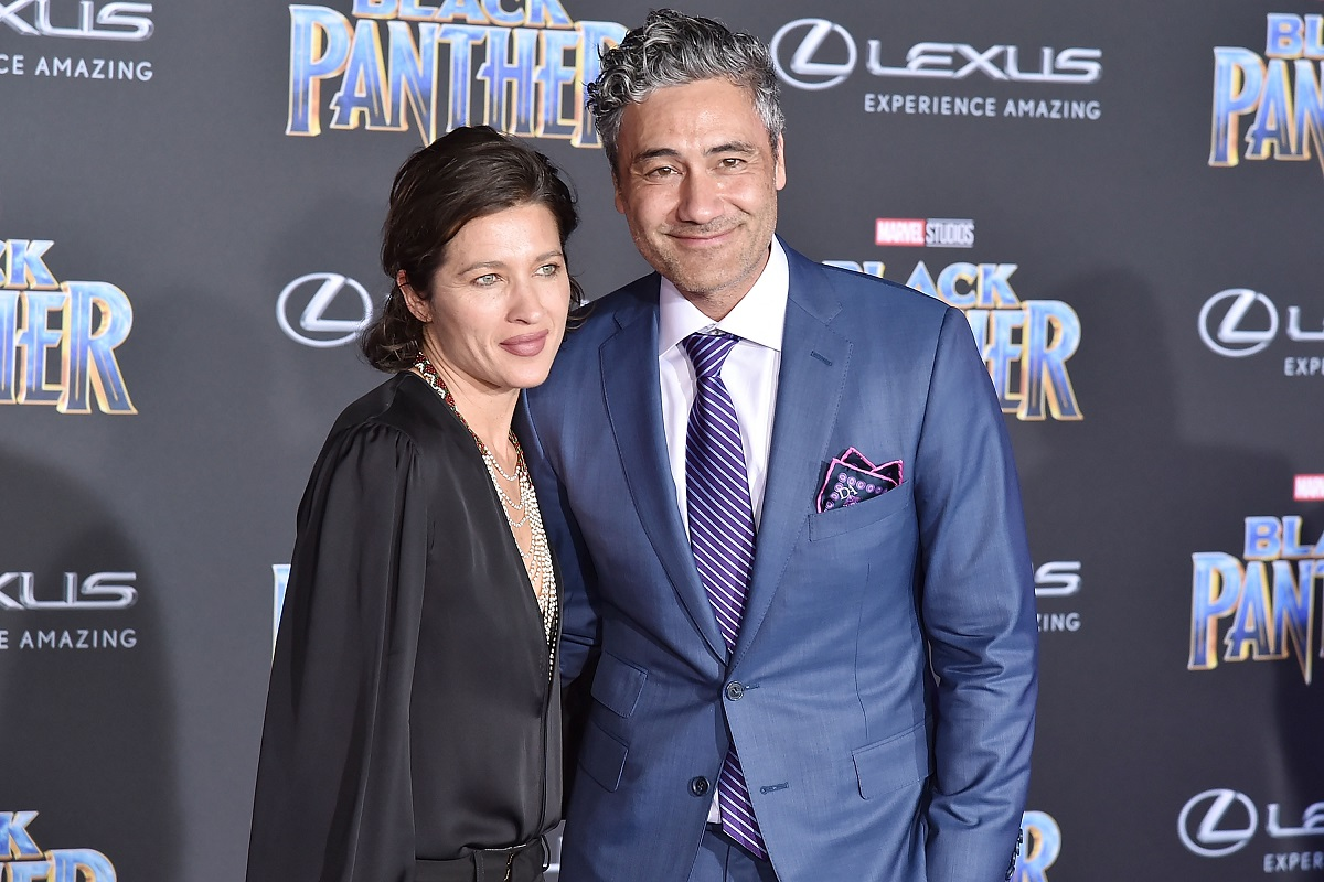 Taika Waititi (R) and Chelsea Winstanley attend the premiere of Disney and Marvel's 'Black Panther' on January 29, 2018, in Hollywood, California.