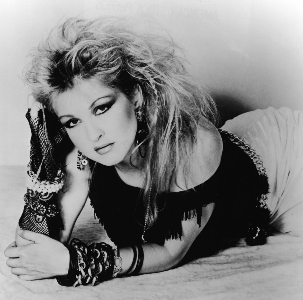 Cyndi Lauper lying on a floor