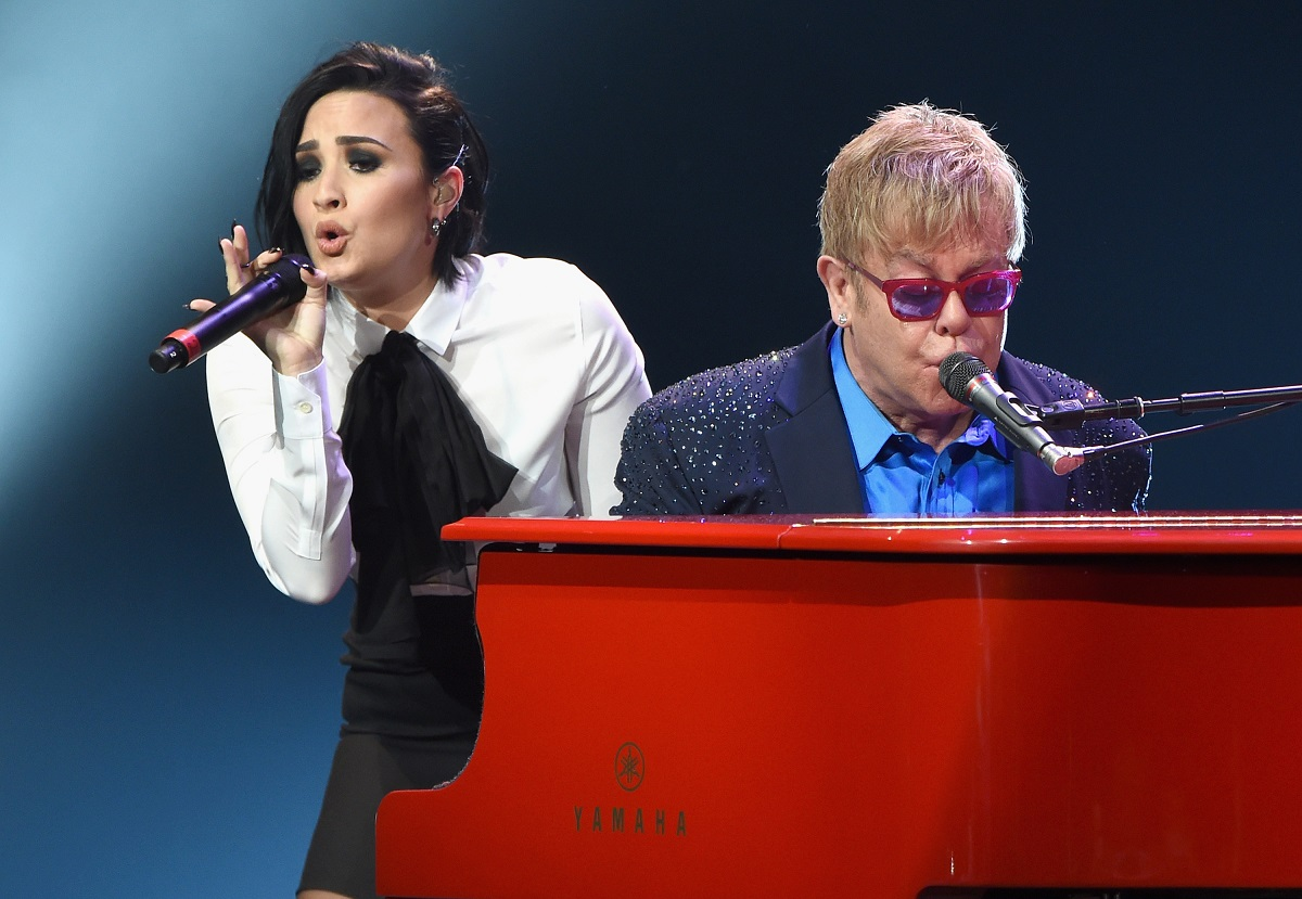 Elton John (R) performing with Demi Lovato on January 13, 2016, at the Wiltern in Los Angeles.