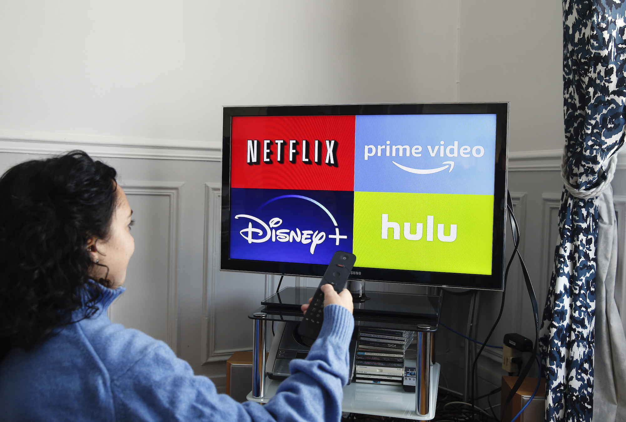 Disney+, Netflix, Hulu, and Amazon Prime logo on a TV