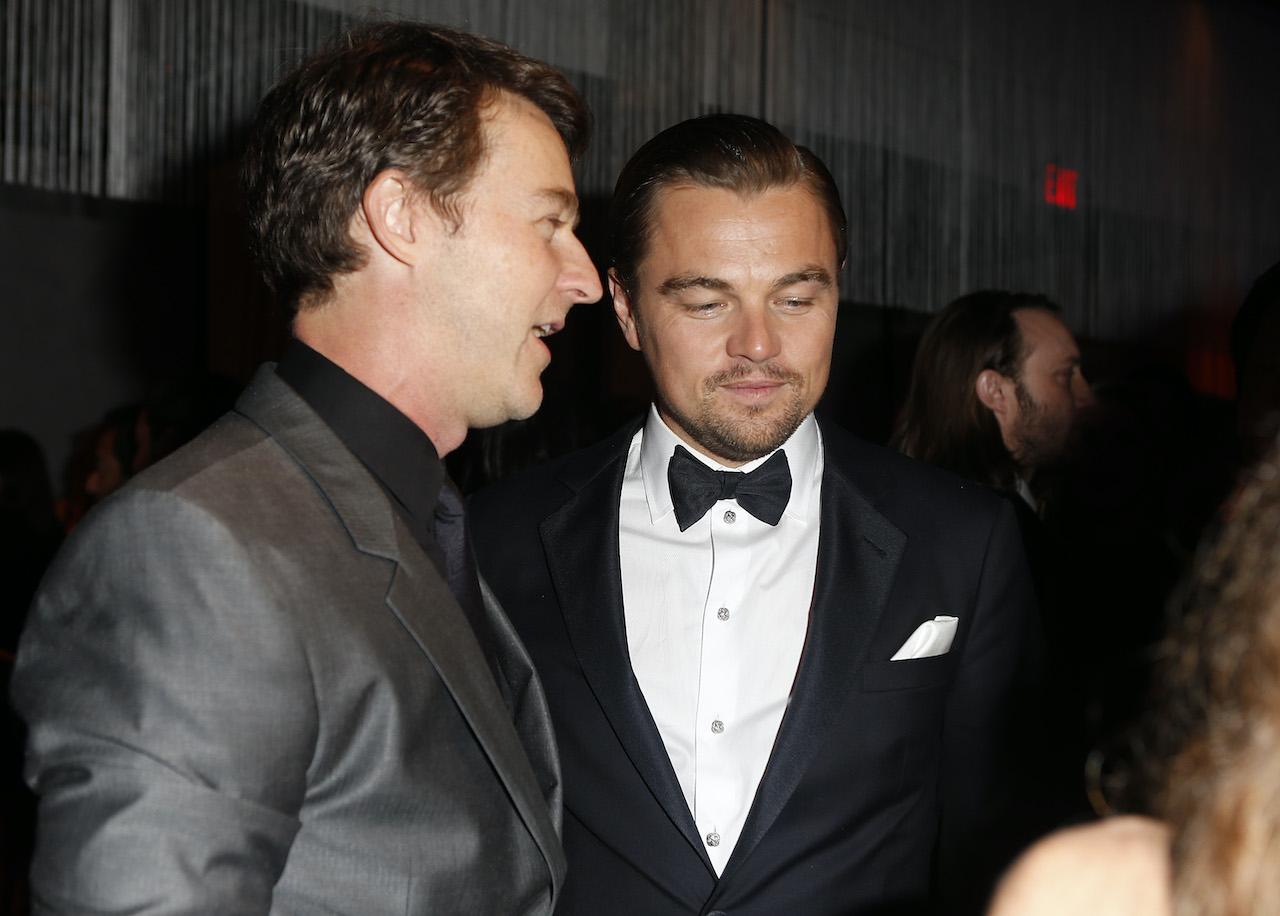 Actors Edward Norton (L) and Leonardo DiCaprio attend the 2014 Vanity Fair Oscar Party