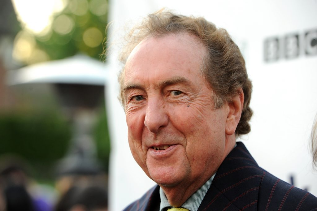 Eric Idle wearing a suit