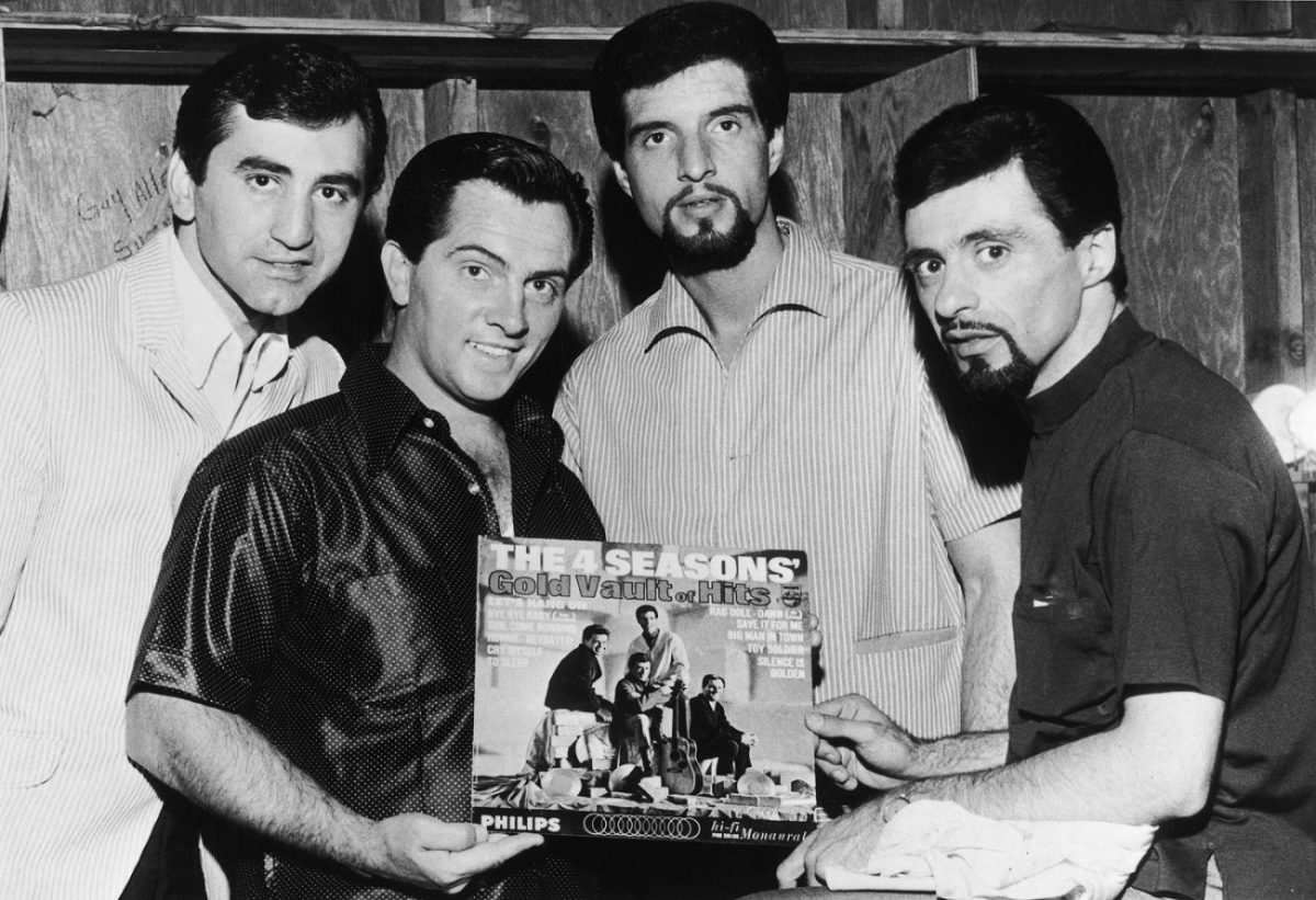 The Four Seasons pose with 1 of their albums in 1966