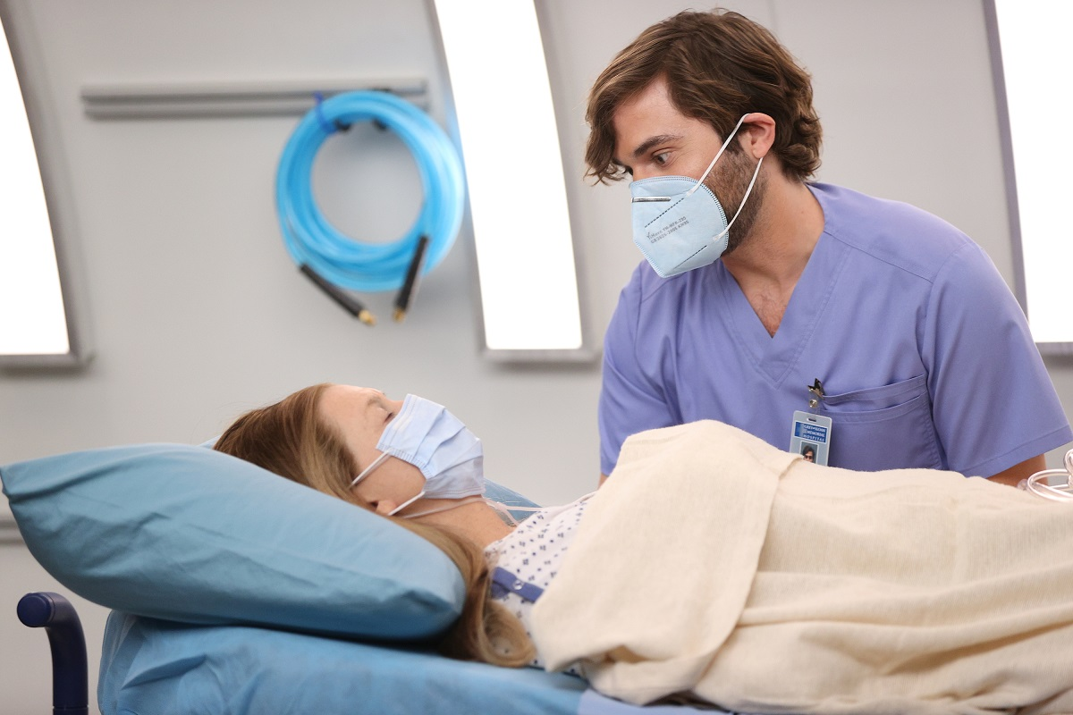 Levi Schmitt (Jake Borelli) with Meredith Grey in 'Grey's Anatomy' Season 17 'Sign O' the Times'