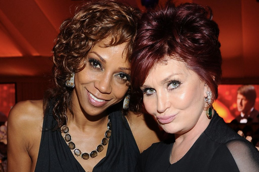 Holly Robinson Peete and Sharon Osbourne share a moment together back in 2011